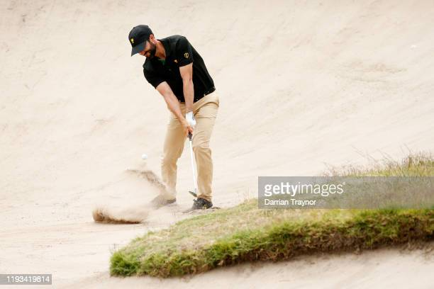 Adam Hadwin of Canada and the International team plays a shot from a bunker on the 11th hole during Thursday four-ball matches on day one of the 2019...