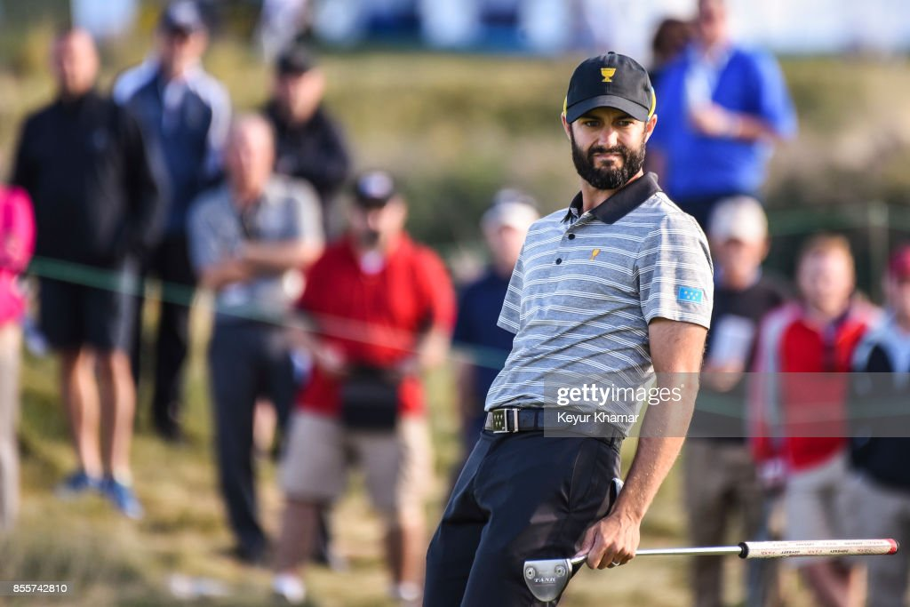 Adam Hadwin of Canada and the International Team reacts after missing a putt on the 17th hole green during Friday Four-Ball matches on Day 2 of the Presidents Cup at Liberty National Golf Club on September 29, 2017, in Jersey City, New Jersey.
