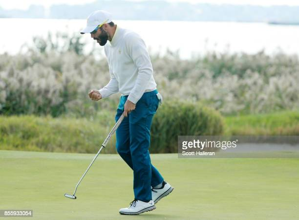 Adam Hadwin of Canada and the International Team reacts to his putt during the Saturday morning foursomes matches during the third round of the...