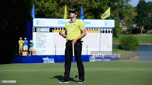 Adam Hadwin of Canada celebrates on the 18th green as he wins the Chiquita Classic held at River Run Country Club on September 7 2014 in Davidson...