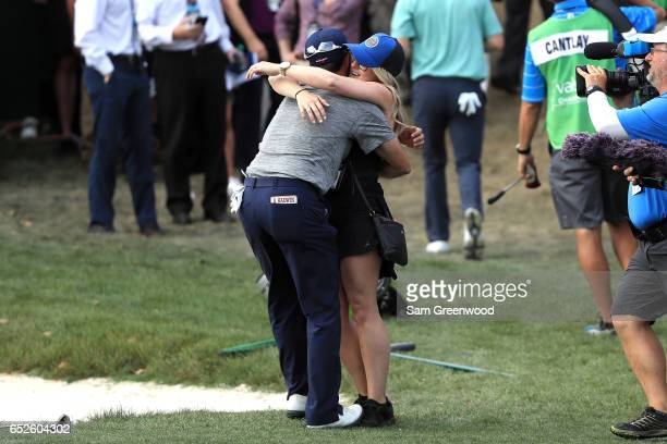 Adam Hadwin of Canada celebrates with fiancee Jessica Dawn Kippenberger on the 18th green after winning the Valspar Championship during the final...