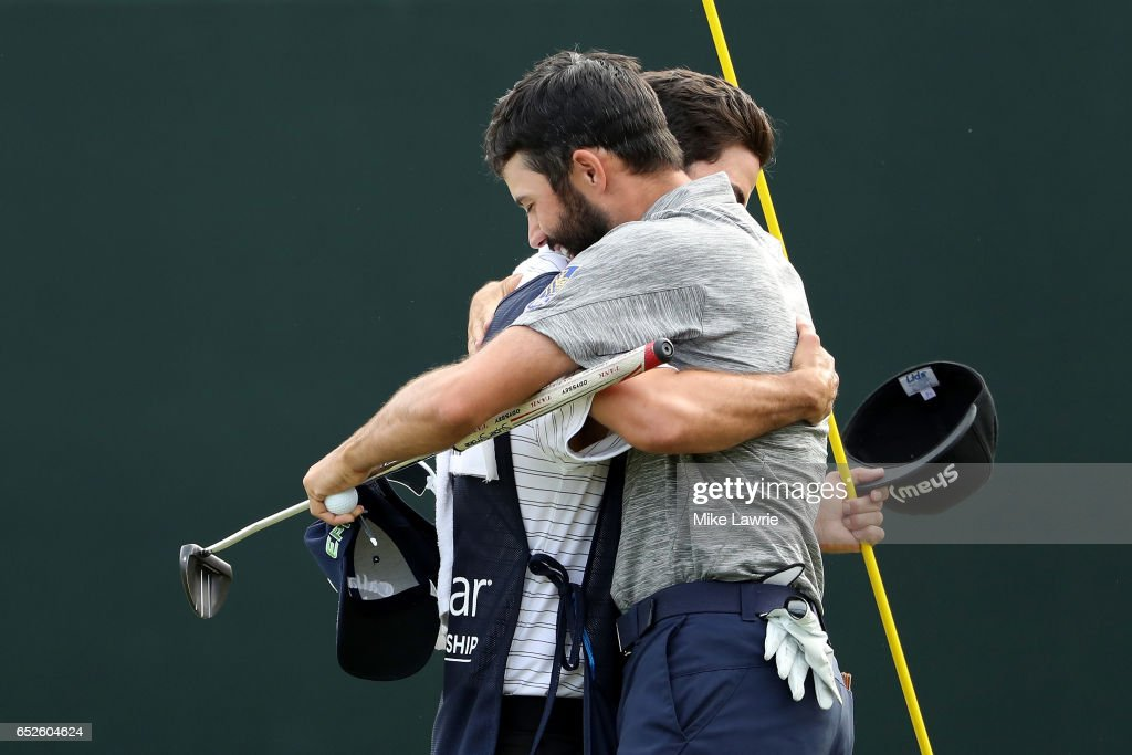 Adam Hadwin of Canada celebrates with his caddie on the 18th green after winning the Valspar Championship during the final round at Innisbrook Resort Copperhead Course on March 12, 2017 in Palm Harbor, Florida. Hadwin won with a score of -14.