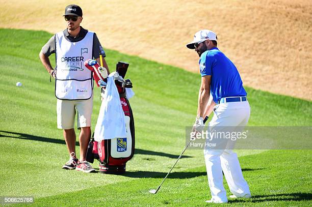 Adam Hadwin of Canada chips onto the first green during the final round of the CareerBuilder Challenge In Partnership With The Clinton Foundation at...