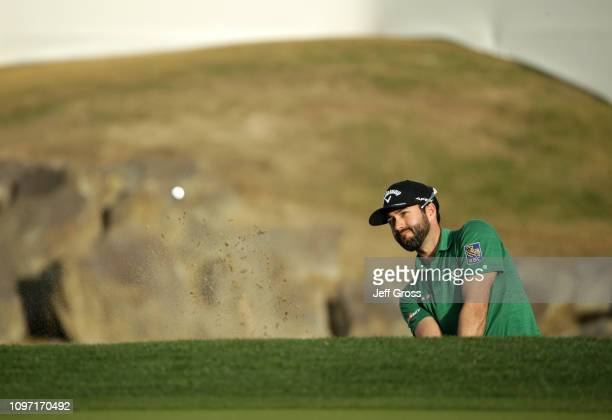 Adam Hadwin of Canada hits a pitch shot to the 18th green during the final round of the Desert Classic at the Stadium Course on January 20 2019 in La...