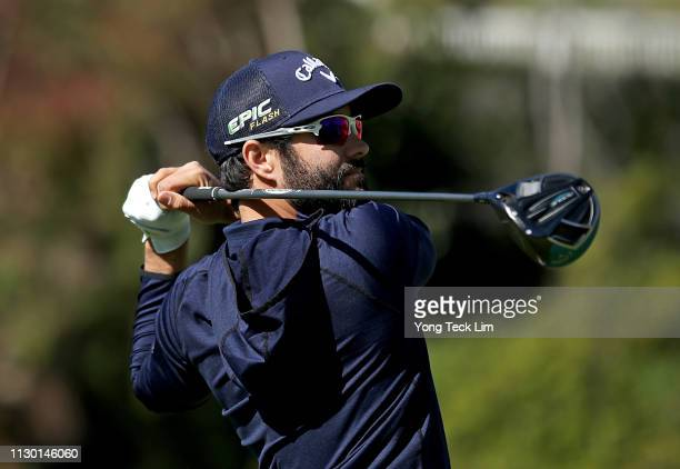 Adam Hadwin of Canada hits a tee shot on the 17th hole during the continuation of the second round of the Genesis Open at Riviera Country Club on...