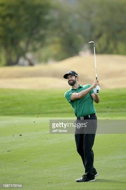 Adam Hadwin of Canada hits his second shot on the 14th hole during the final round of the Desert Classic at the Stadium Course on January 20 2019 in...
