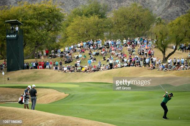 Adam Hadwin of Canada hits his second shot on the 15th fairway during the final round of the Desert Classic at the Stadium Course on January 20 2019...