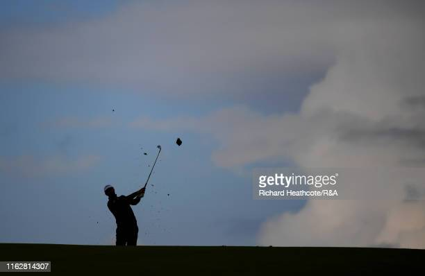 Adam Hadwin of Canada hits his second shot on the 17th hole during the first round of the 148th Open Championship held on the Dunluce Links at Royal...