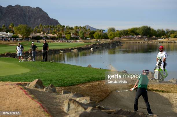 Adam Hadwin of Canada hits out of the bunker on the 18th hole during the final round of the Desert Classic at the Stadium Course on January 20 2019...