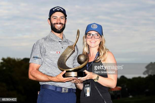 Adam Hadwin of Canada holds the trophy with fiancee Jessica Dawn Kippenberger after winning the Valspar Championship during the final round at...