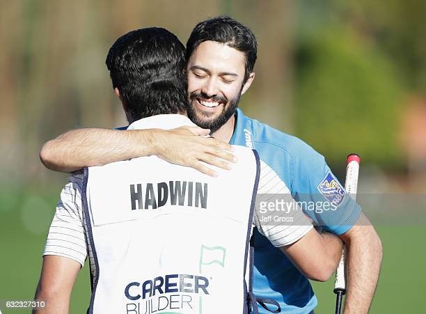 Adam Hadwin of Canada hugs his caddie Joe Cruz after shooting a 59 during the third round of the CareerBuilder Challenge in Partnership with The...
