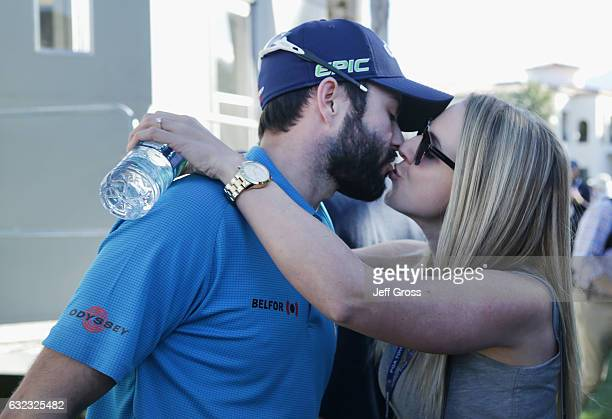 Adam Hadwin of Canada kisses his fiance Jessica Kippenberger after shooting a 59 during the third round of the CareerBuilder Challenge in Partnership...