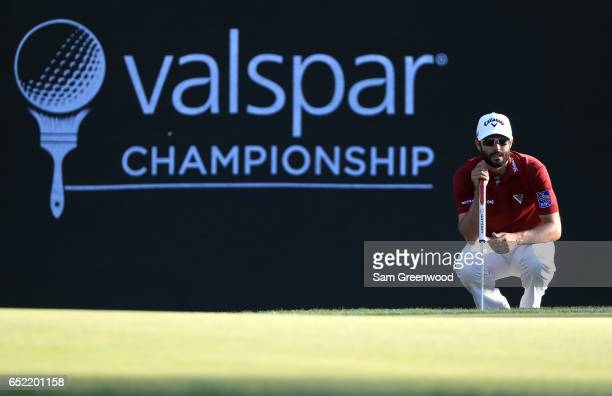 Adam Hadwin of Canada lines up a putt on the 16th green during the third round of the Valspar Championship at Innisbrook Resort Copperhead Course on...