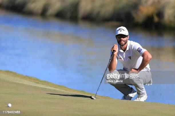 Adam Hadwin of Canada lines up a putt on the 18th green during the final round of the Shriners Hospitals for Children Open at TPC Summerlin on...