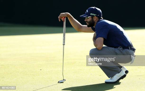 Adam Hadwin of Canada lines up a putt on the 18th green during the second round of the Valspar Championship at Innisbrook Resort Copperhead Course on...