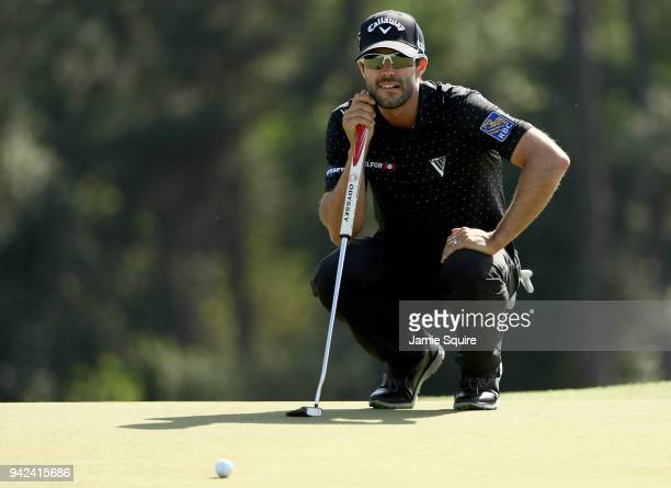 Adam Hadwin of Canada lines up a putt on the 18th green during the first round of the 2018 Masters Tournament at Augusta National Golf Club on April...