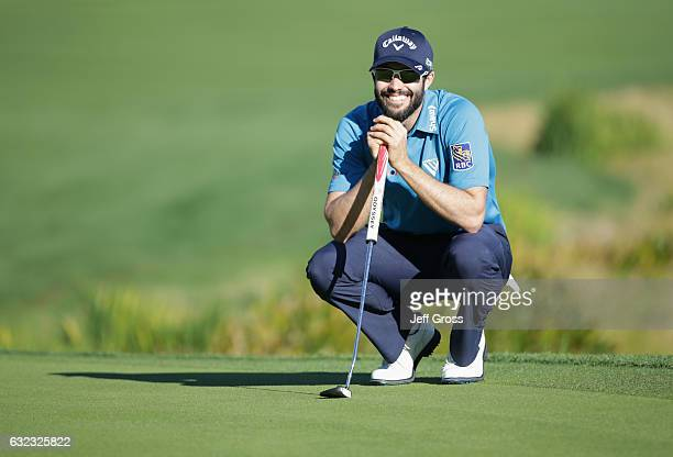 Adam Hadwin of Canada lines up a putt on the 18th hole during the third round of the CareerBuilder Challenge in Partnership with The Clinton...