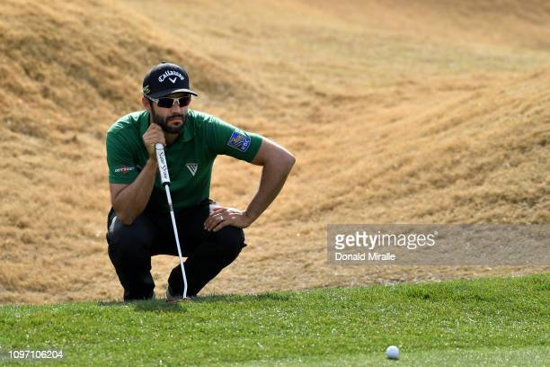 Adam Hadwin of Canada lines up a putt on the 1st hole during the final round of the Desert Classic at the Stadium Course on January 20 2019 in La...