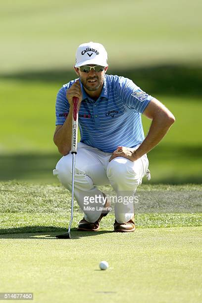 Adam Hadwin of Canada lines up a putt on the second green during the first round of the Valspar Championship at Innisbrook Resort Copperhead Course...