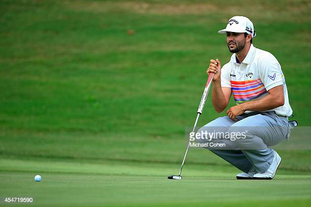 Adam Hadwin of Canada lines up his putt for eagle on the sixth green during the second round of the Chiquita Classic held at River Run Country Club...