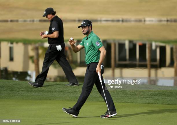 Adam Hadwin of Canada makes a birdie during the final round of the Desert Classic at the Stadium Course on January 20 2019 in La Quinta California