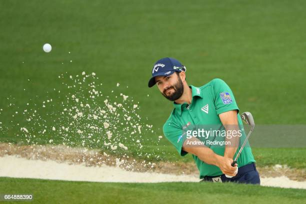Adam Hadwin of Canada plays a shot from a bunker during a practice round prior to the start of the 2017 Masters Tournament at Augusta National Golf...