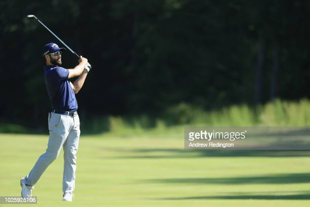 Adam Hadwin of Canada plays a shot on the ninth hole during round two of the Dell Technologies Championship at TPC Boston on September 1 2018 in...