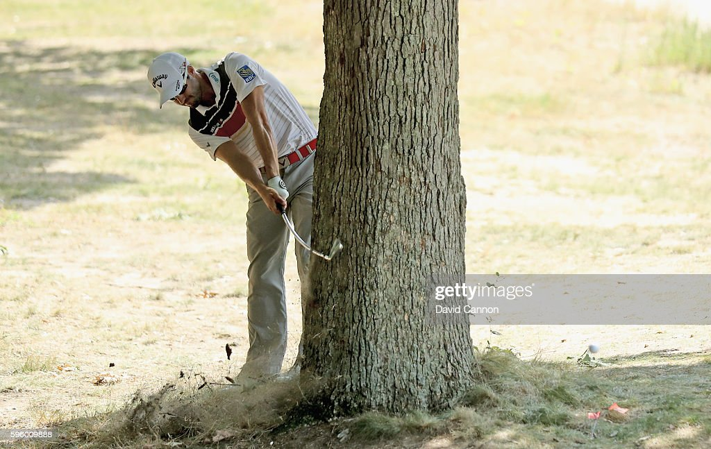 Adam Hadwin of Canada plays his second shot from behind a big tree and bends his club's shaft on teh par 4, fifth hole during the second round of The Barclays in the PGA Tour FedExCup Play-Offs on the Black Course at Bethpage State Park on August 26, 2016 in Farmongdale, New York.