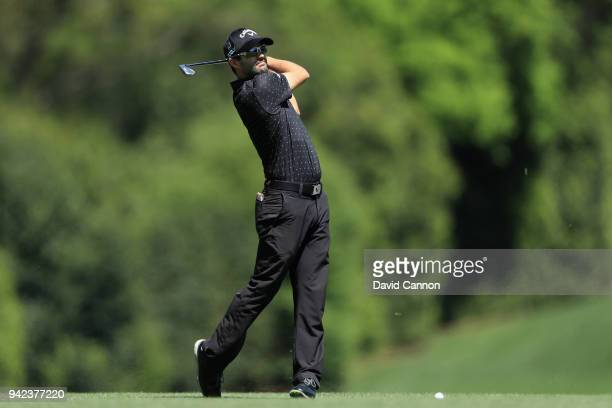 Adam Hadwin of Canada plays his second shot on the fifth hole during the first round of the 2018 Masters Tournament at Augusta National Golf Club on...