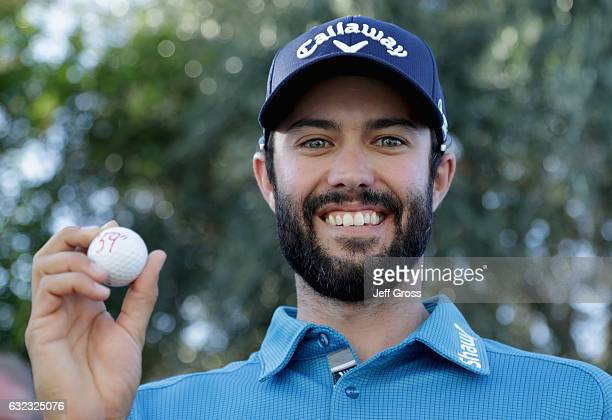Adam Hadwin of Canada poses with his ball after shooting a 59 during the third round of the CareerBuilder Challenge in Partnership with The Clinton...