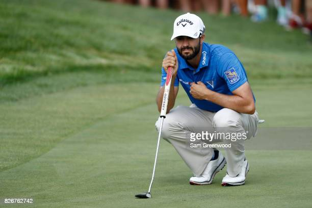 Adam Hadwin of Canada putts on the 18th green during the third round of the World Golf Championships Bridgestone Invitational at Firestone Country...