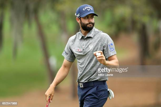 Adam Hadwin of Canada reacts after putting on the second green during the final round of the Valspar Championship at Innisbrook Resort Copperhead...