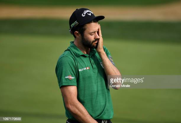 Adam Hadwin of Canada reacts to a missed birdie putt on the 15th green during the final round of the Desert Classic at the Stadium Course on January...