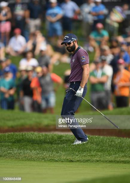 Adam Hadwin of Canada reacts to his shot on the 18th hole during the first round at the RBC Canadian Open at Glen Abbey Golf Club on July 26 2018 in...