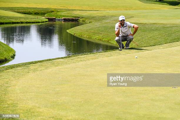 Adam Hadwin of Canada reads his putt on the 14th hole green during the final round of the Memorial Tournament presented by Nationwide at Muirfield...