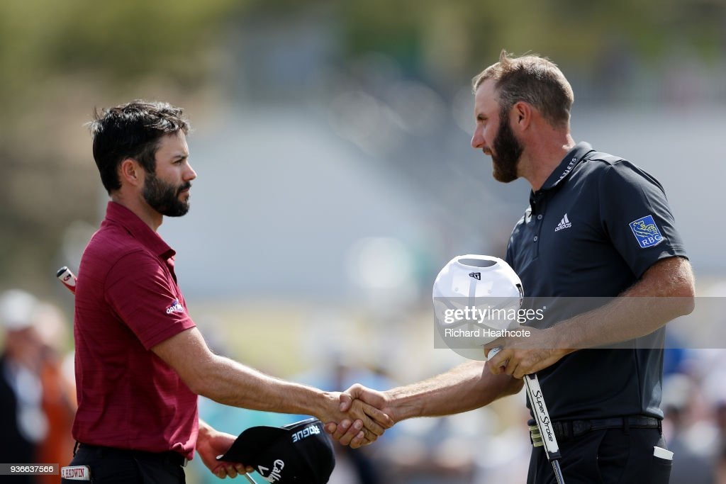 Adam Hadwin (L) of Canada shakes hands with Dustin Johnson of the United States after defeating him 4&3 on the 15th green during the second round of the World Golf Championships-Dell Match Play at Austin Country Club on March 22, 2018 in Austin, Texas.