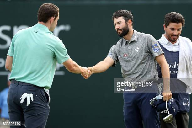 Adam Hadwin of Canada shakes hands with Patrick Cantlay on the 18th green after winning the Valspar Championship during the final round at Innisbrook...