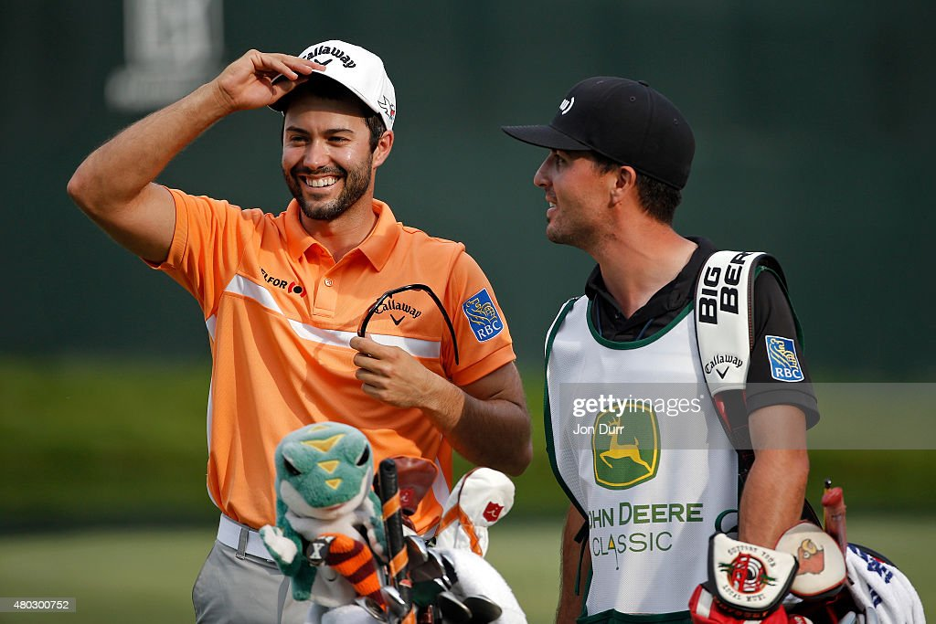 Adam Hadwin of Canada smiles while talking to his caddie Joe Cruz after making a birdie on the 18th hole during the second round of the John Deere Classic held at TPC Deere Run on July 10, 2015 in Silvis, Illinois.