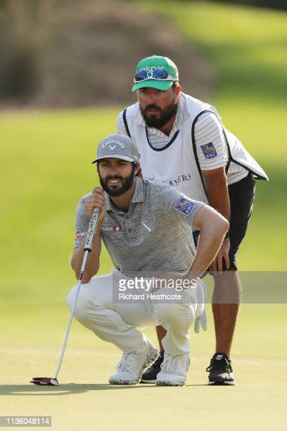 Adam Hadwin of Canada talks with his caddie during the second round of The PLAYERS Championship on The Stadium Course at TPC Sawgrass on March 15...