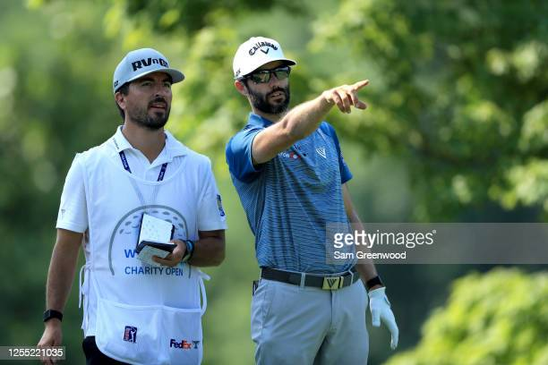 Adam Hadwin of Canada talks with his caddie on the fifth tee during the first round of the Workday Charity Open on July 09, 2020 at Muirfield Village...