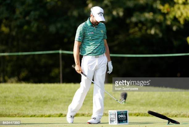 Adam Hadwin of Canada taps the tee marker after a poor tee shot on 16 during the final round of the Dell Technologies Championship on September 4 at...