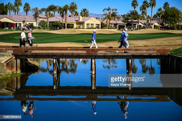 Adam Hadwin of Canada walks across the bridge to the 15th hole green during the third round of the Desert Classic on the Nicklaus Tournament Course...