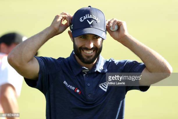 Adam Hadwin of Canada walks off the 18th green as the leader during the second round of the Valspar Championship at Innisbrook Resort Copperhead...