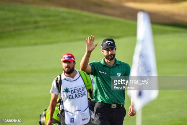 Adam Hadwin of Canada waves to fans on the 18th hole green during the final round of the Desert Classic on the Stadium Course at PGA West on January...