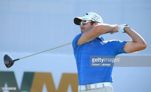 Adam Hadwin watches his tee shot on the 17th hole during the first round of the Waste Management Phoenix Open at TPC Scottsdale on February 1 2018 in...