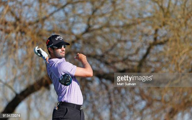 Adam Hadwin watches his tee shot on the sixth hole during the second round of the Waste Management Phoenix Open at TPC Scottsdale on February 2 2018...