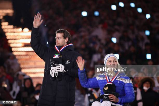 Adam Hall of New Zealand and Sini Pyy of Finland are awarded the Whang Youn Dai Achievement Awards during the closing ceremony of the PyeongChang...