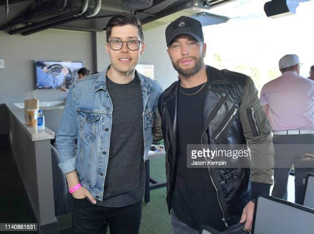 Adam Hambrick and Chris Lane attend the ACM Lifting Lives TOPGOLF TeeOff at TOPGOLF on April 06 2019 in Las Vegas Nevada