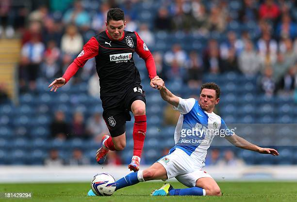 Adam Hamill of Huddersfield Town beats Corry Evans of Blackburn Rovers during the Sky Bet Championship match between Blackburn Rovers and...
