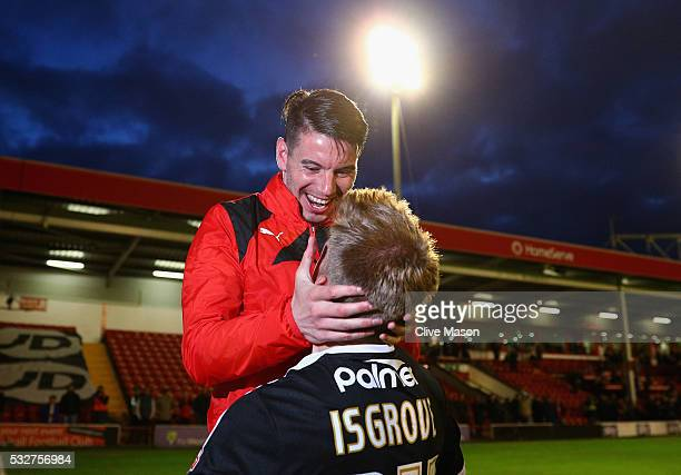 Adam Hammill of Barnsley celebrates with team mate Lloyd Isgrove of Barnsley after winning the Sky Bet League One play off second leg match between...